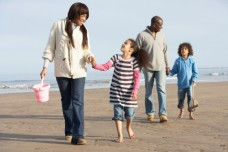 family-walking-beach-120213